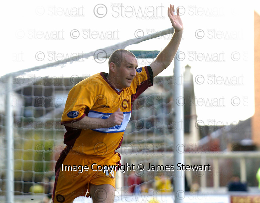 01/04/2006         Copyright Pic: James Stewart.File Name : sct_jspa02_motherwell_v_livingston.JIM HAMILTON CELEBRATES AFTER HE SCORES MOTHERWELL'S FIRST...Payments to :.James Stewart Photo Agency 19 Carronlea Drive, Falkirk. FK2 8DN      Vat Reg No. 607 6932 25.Office     : +44 (0)1324 570906     .Mobile   : +44 (0)7721 416997.Fax         : +44 (0)1324 570906.E-mail  :  jim@jspa.co.uk.If you require further information then contact Jim Stewart on any of the numbers above.........