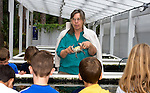 Anne Rudloe explains to a group of elementary school children how to identify a female blue crab at their Gulf Specimen Marine Lab in Panacea, Florida May 20, 2009.  (Mark Wallheiser/TallahasseeStock.com)
