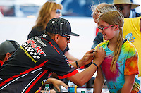 Jun 10, 2016; Englishtown, NJ, USA; NHRA top fuel driver J.R. Todd signs autographs during qualifying for the Summernationals at Old Bridge Township Raceway Park. Mandatory Credit: Mark J. Rebilas-USA TODAY Sports