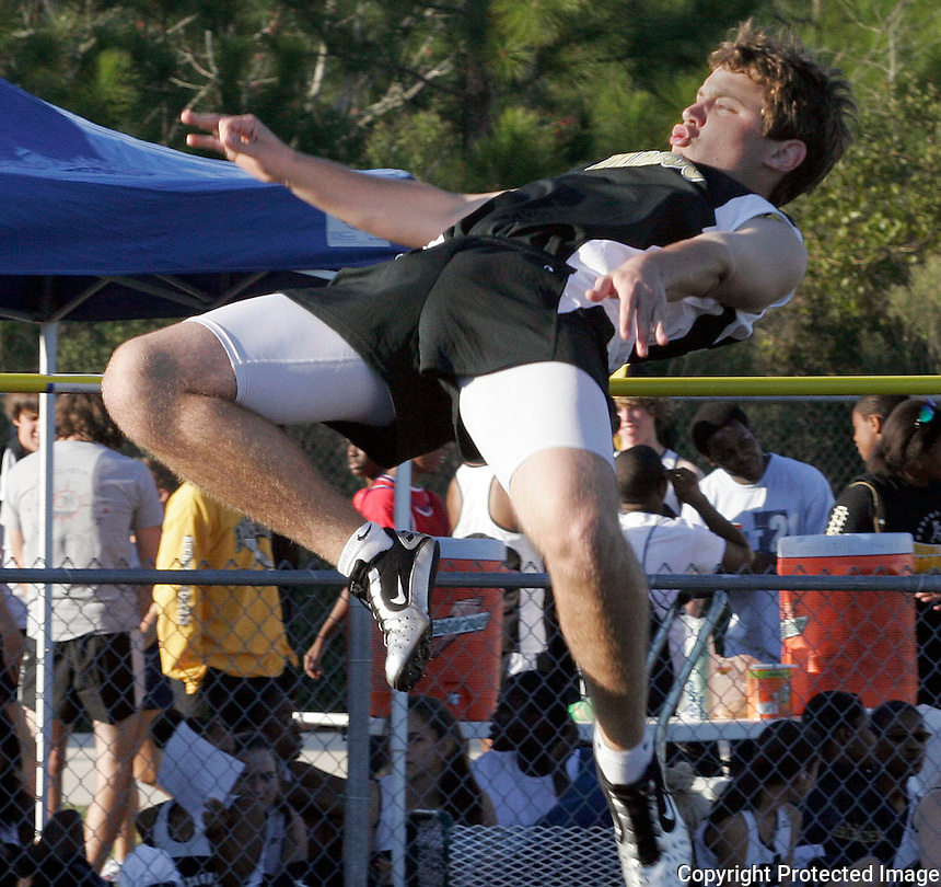 03/03/06.......Gary Wilcox/The Times Union.....Nease High's Kyle Tanner (#47) does a jump at the Bartram Trail High co-ed track meet last Friday (03/3/06).