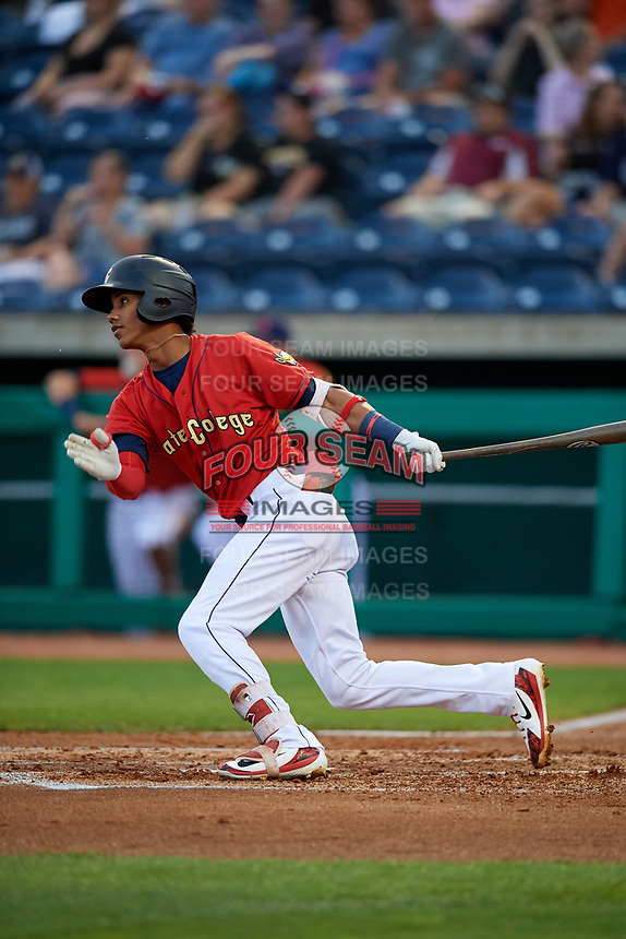 State College Spikes center fielder Wadye Ynfante (12) follows through on a swing during a game against the West Virginia Black Bears on August 30, 2018 at Medlar Field at Lubrano Park in State College, Pennsylvania.  West Virginia defeated State College 5-3.  (Mike Janes/Four Seam Images)