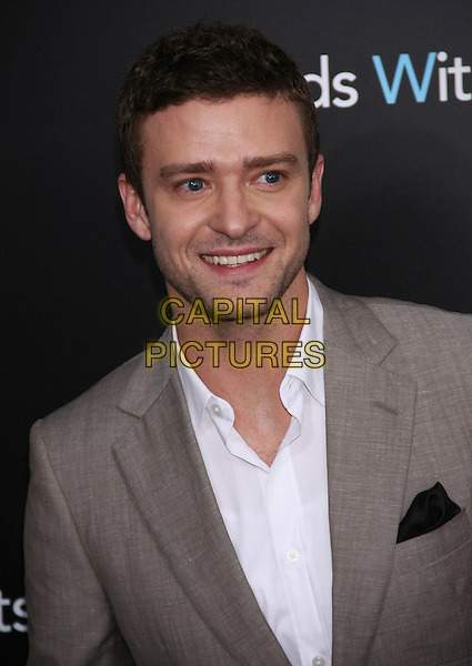 "Justin Timberlake.The New York Premiere of ""Friends With Benefits"" at the Ziegfeld Theater, New York, NY, USA..July 18th, 2011.headshot portrait smiling white shirt beige suit jacket stubble facial hair .CAP/LNC/TOM.©LNC/Capital Pictures."