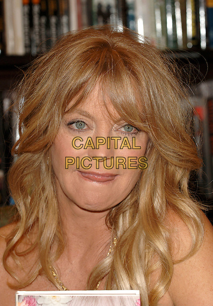 """GOLDIE HAWN .Signing her new book """"Goldie: A Lotus Grows In The Mud"""" at Barnes & Noble/The Grove, Los Angeles, California..May 11th, 2005.headshot portrait tongue.www.capitalpictures.com.sales@capitalpictures.com.©Capital Pictures."""