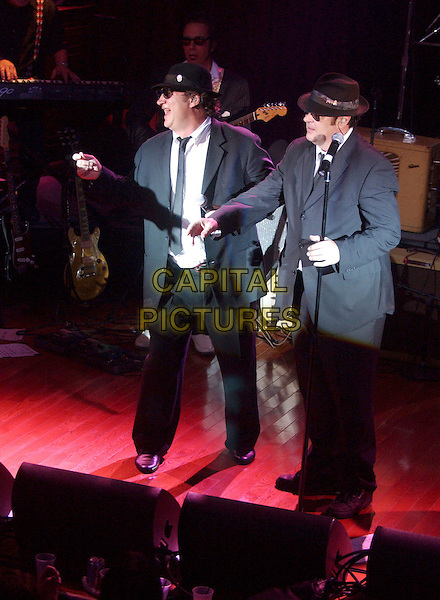 JIM BELUSHI & DAN AYKROYD.feature in The Blues Brothers Revue during the grand opening celebration at the Cleveland House of Blues Club, Cleveland, Ohio, USA, .28th November 2004  .full length show stage concert costume.Ref: ADM.www.capitalpictures.com.sales@capitalpictures.com.©Laura Farr/AdMedia/Capital Pictures .