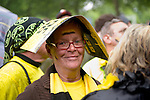 A woman protects her hairs from getting wet because of a  rain shower. - In Dortmund fans celebrated a gigantic party because of the title win of their favorite soccer club BVB 09 in the German Premium League.