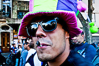 a man smokes a marijuana cigaret as he takes part in a rally to support Marijuana decriminalization in Buenos Aires, Argentina May 4, 2013. Photo by Juan Gabriel Lopera / VIEWpress.