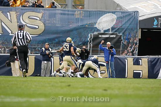 Trent Nelson  |  The Salt Lake Tribune.Photographer cheers Pitt touchdown. during the first half. Utah vs. Pitt, college football at Heinz Field Stadium in Pittsburgh, Pennsylvania, Saturday, October 15, 2011.