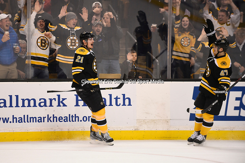 March 31, 2015 - Boston, Massachusetts, U.S.- Boston Bruins left wing Loui Eriksson (21) celebrates his goal with defenseman Torey Krug (47) during the NHL match between the Florida Panthers and the Boston Bruins held at TD Garden in Boston Massachusetts. Eric Canha/CSM