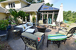 """Patio outside the conservatory has a fire pit at the center. """"At Home"""" with Margaret Lowery in her Lake Christine Drive home in Belleville, IL on July 24, 2019. <br /> Photo by Tim Vizer"""