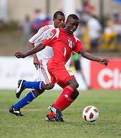 Lazaro Mezquia (17) of Cuba tries to keep up with Alexander Gonzalez (20) of Panama during the group stage of the CONCACAF Men's Under 17 Championship at Jarrett Park in Montego Bay, Jamaica. Panama tied Cuba, 0-0.