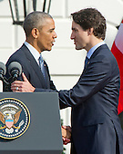 United States President Barack Obama, left, shakes hands with Prime Minister Justin Trudeau of Canada, right, during an Arrival Ceremony on the South Lawn of the White House in Washington, DC on Thursday, March 10, 2016. <br /> Credit: Ron Sachs / CNP