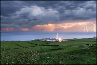 BNPS.co.uk (01202 558833)<br /> Pic: IslandVisions/BNPS<br /> <br /> ***Must use full byline***<br /> <br /> Lightning over St Catherines Lighthouse, Niton on the Isle of Wight captured by photographer Jamie Russell (36) from Shanklin, Isle of Wight.<br /> <br /> The dramatic weather conditions formed as warm air clashed with a cold front moving in over the country.