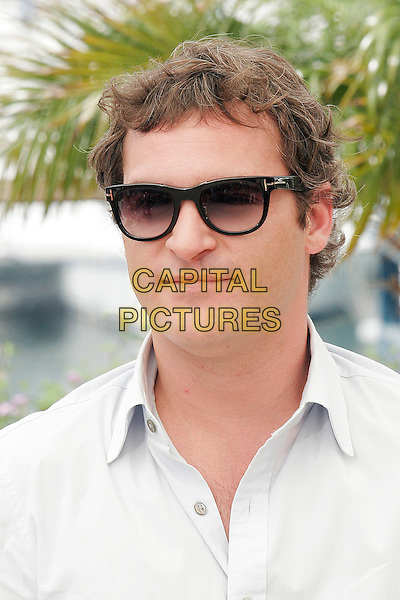 "JOAQUIN PHOENIX.Photocall for ""We Own the Night "" during the 60th International Cannes Film Festival, Cannes, France. .May 25th, 2007.headshot portrait sunglasses shades .CAP/DAR.©Darwin/Capital Pictures"