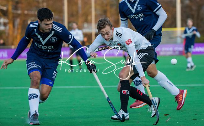 AMSTELVEEN - Floris Middendorp (Adam) met Alexander Hendrickx (Pinoke)  tijdens de competitie hoofdklasse hockeywedstrijd heren, Pinoke-Amsterdam (1-1)   COPYRIGHT KOEN SUYK