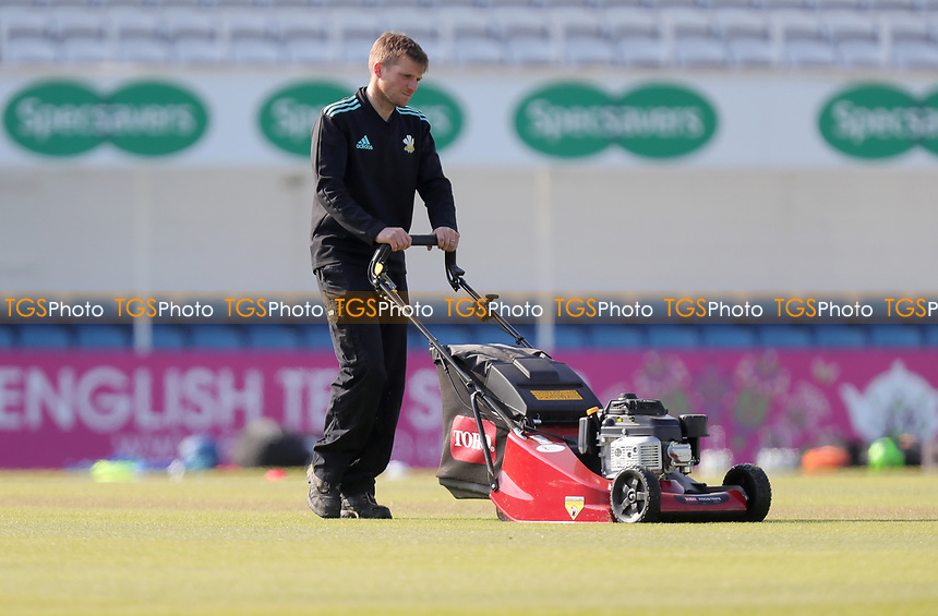 Ground staff prepare the outfield prior to Surrey CCC vs Essex CCC, Specsavers County Championship Division 1 Cricket at the Kia Oval on 14th April 2019
