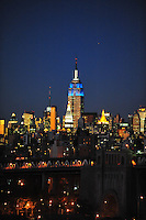 Nov. 12, 2010 - New York City, NY - New York City photographed from the Brooklyn Bridge at sunset November 12, 2010. The Empire State Building towers above the skyline. (Photo by Alan Greth)