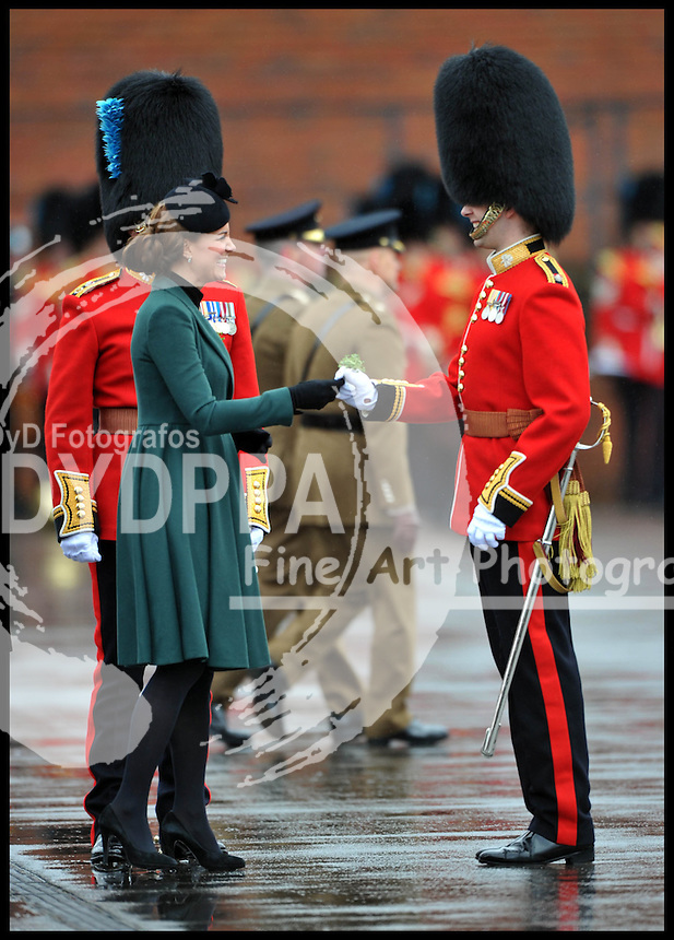 HRH The Duchess of Cambridge and Prince William attend The Irish Guards' St Patrick's Day Parade with the shamrock being presented by HRH The Duchess of Cambridge, Sunday March 17, 2013. Photo By Andrew Parsons / i-Images/DyD Fotografos