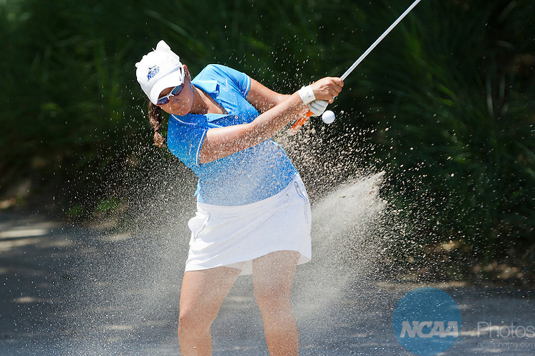 18 MAY 2013:  Daniela Ortiz of Nova Southern University blasts out of a bunker during the Division II Women's Golf Championship held at the LPGA International Golf Course in Daytona Beach, FL.  The sand only slowed her down a little as she went on to place third overall in the singles division. Lynn University shot a +17 to win the national title by 3 strokes.  Matt Marriott/NCAA Photos