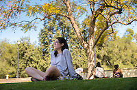 Ellen Hee '19 enjoys a sunny afternoon in winter near the Academic Quad, Feb. 9, 2016.<br /> (Photo by Marc Campos, Occidental College Photographer)