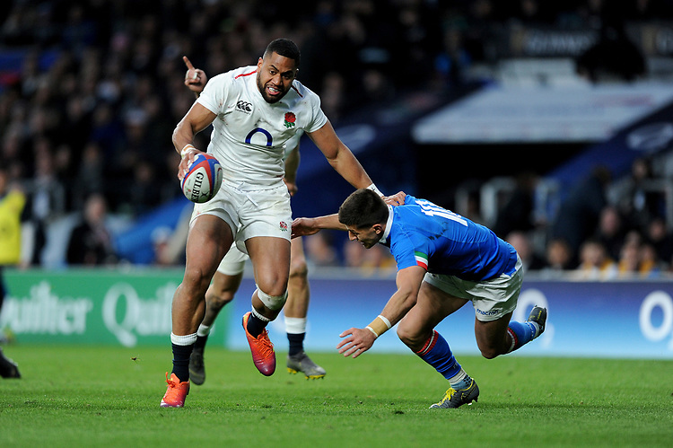 Joe Cokanasiga of England hands off Tommaso Allan of Italy during the Guinness Six Nations match between England and Italy at Twickenham Stadium on Saturday 9th March 2019 (Photo by Rob Munro/Stewart Communications)