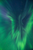 Aurora corona fills sky over Lofoten Islands, Norway