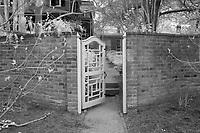 Classic garden gate behind Pavilion V at the University of Virginia in Charlottesville, Va. Photo/Andrew Shurtleff Photography, LLC