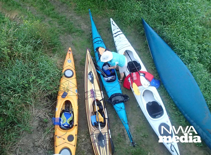 A paddler gets her kayak ready.