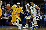 29 December 2014: Toledo's J.D. Weatherspoon (24) and Duke's Tyus Jones (5). The Duke University Blue Devils hosted the University of Toledo Rockets at Cameron Indoor Stadium in Durham, North Carolina in a 2014-16 NCAA Men's Basketball Division I game. Duke won the game 86-69.
