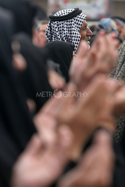 KARBALA, IRAQ: A Shia pilgrim prays...Shia pilgrims pray during the last day of the Ashura festival...Photo by Metrography