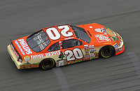 "Tony Stewart drives the #20 ""Great Pumpkin"" - Home Depot car."