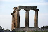 CORINTH, GREECE - APRIL 15 : A view from below of the Temple of Apollo, on April 15, 2007 in Corinth, Greece. Standing prominently on a knoll the Temple of Apollo was built in the 7th century BC in the Doric Order. Seven of its original 38 columns remain standing and are seen here in the afternoon light. It is one of the oldest temples in Greece. Corinth, founded in Neolithic times, was a major Ancient Greek city, until it was razed by the Romans in 146 BC. Rebuilt a century later it was destroyed by an earthquake in Byzantine times.(Photo by Manuel Cohen)