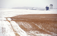 Field of snow on farm.