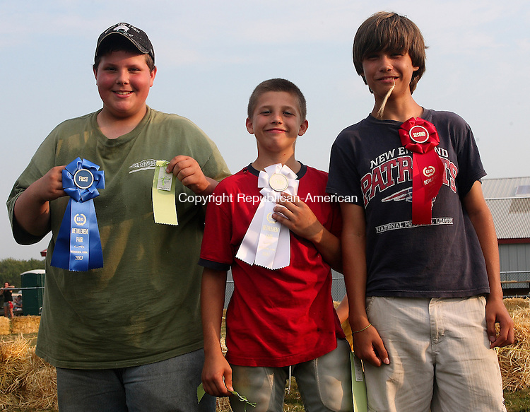 (From Left) First place winner Jake Magini, Third place winner Mischa Hoffman and Second place wineer Gunner Hoffman pose with their ribbons after participating in the first ever animal call at the 2007 Annual Bethlehem Fair. Michael Kabelka Republican / American.