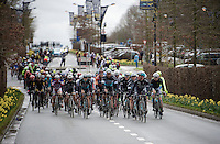 the peloton enters Oudenaarde as Iljo Keisse (BEL/Etixx-QuickStep) cautions them for the dangerous roundabout ahead<br /> <br /> 70th Dwars Door Vlaanderen 2015
