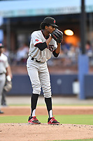 Hickory Crawdads starting pitcher Tyree Thompson (13) looks in for the sign during a game against the Asheville Tourists at McCormick Field on August 17, 2018 in Asheville, North Carolina. The Tourists defeated the Crawdads 6-3. (Tony Farlow/Four Seam Images)