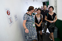 Pavilion Director Annikka Alanko (left) and Zhou Wei (right) welcome Finland's Pavilion's 4 millionth visitor Liu Xin (center), in Finnish Pavilion 'Kirnu' on Shanghai World Expo 2010 site, in Shanghai, China, on September 19, 2010. Photo by Lucas Schifres/Pictobank