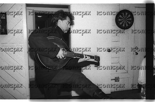 """JOHNNY CASH - Marty Stuart during the recording sessions for Johnny Cash's """"Unchained"""" CD Produced by Rick Rubin.   Photographed at Sound City Studios in Van Nuys, CA USA - January 26, 1996.  Photo © Kevin Estrada / Iconicpix"""