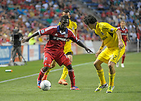 Chicago midfielder Patrick Nyarko (14) maneuvers with the ball in an effort to get around Columbus defender Nemanja Vukovic (32).  The Chicago Fire defeated the Columbus Crew 2-1 at Toyota Park in Bridgeview, IL on June 23, 2012.