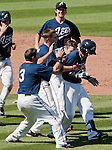 Reno Aces Tyler Bortnick is mobbed by his teammates after knocking in the winning run in the bottom of the 9th inning against the Tucson Padres in their game played on Monday afternoon, September 3, 2012 in Reno, Nevada.