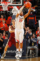 Virginia forward Akil Mitchell (25) grabs a rebound next to during the game Saturday in Charlottesville, VA. Virginia won 65-45.
