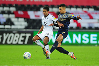 Kyle Naughton of Swansea City under pressure from Jacob Brown of Barnsley during the Sky Bet Championship match between Swansea City and Barnsley at the Liberty Stadium in Swansea, Wales, UK. Sunday 29 December 2019