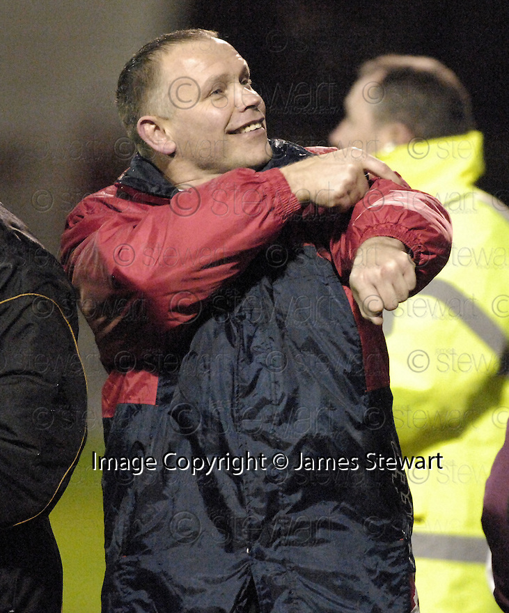 22/12/2007      Copyright Pic: James Stewart.File Name : sct_jspa25_motherwell_v_falkirk.A HAPPY FALKIRK MANAGER JOHN HUGHES AT THE END OF THE GAME AFTER THEY BEAT MOTHERWELL 3-0.James Stewart Photo Agency 19 Carronlea Drive, Falkirk. FK2 8DN      Vat Reg No. 607 6932 25.Office     : +44 (0)1324 570906     .Mobile   : +44 (0)7721 416997.Fax         : +44 (0)1324 570906.E-mail  :  jim@jspa.co.uk.If you require further information then contact Jim Stewart on any of the numbers above.........