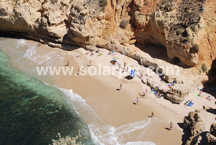 **ALL ROUND PICTURES FROM SOLARPIX.COM**.**WORLDWIDE SYNDICATION RIGHTS**.Carvoeiro, Portugal..This pic: While hundreds of visitors crowd Carvoeiro beach, just 250 metres to the West is the beautiful secluded Paradise Beach (Praia do Paraiso). Over 100 steps lead down to the beach (and over a 100 lead back up at the end of the day)...JOB REF:    4376    PPL        DATE: 25_07_2007.**MUST CREDIT SOLARPIX.COM OR DOUBLE FEE WILL BE CHARGED* *UNDER NO CIRCUMSTANCES IS THIS IMAGE TO BE REPRODUCED FOR ANY ONLINE EDITION WITHOUT PRIOR PERMISSION*
