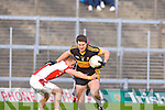 Dr Crokes Eoin Brosnan does past Rathmore's Conor O'Sullivan during the O'Donoghue Cup final in Fitzgerald Stadium on Sunday