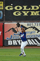 Jacob Scavuzzo (7) of the Ogden Raptors makes the catch in action against the Great Falls Voyagers at Lindquist Field on August 13, 2013 in Ogden Utah. (Stephen Smith/Four Seam Images)