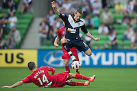 MELBOURNE, AUSTRALIA - JANUARY 09: Mate Dugandzic of the Victory evades a tackle by Cameron Watson of United during the round 22 A-League match between the Melbourne Victory and Adelaide United at AAMI Park on January 9, 2011 in Melbourne, Australia. (Photo by Sydney Low / Asterisk Images)