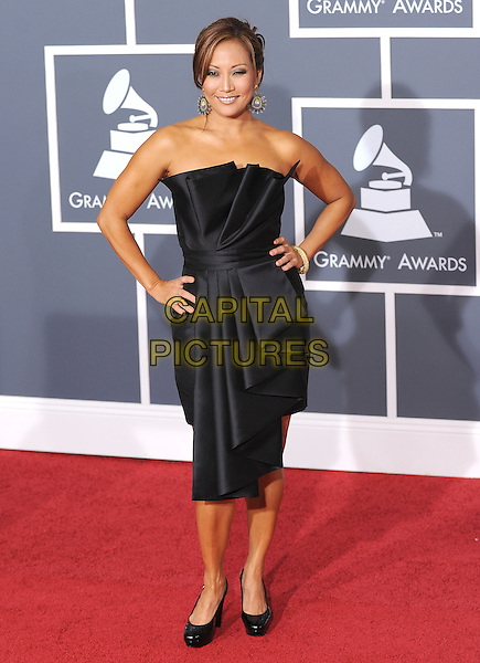 CARRIE ANN INABA.Arrivals at the 52nd Annual GRAMMY Awards held at The Staples Center in Los Angeles, California, USA..January 31st, 2010.grammys full length black strapless dress pleats pleated folds folded origami hands on hips.CAP/RKE/DVS.©DVS/RockinExposures/Capital Pictures