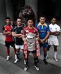International rugby players (L-R) Cyrus Homayoum of UAE, Simon Leung of Hong Kong, Ayumu Goromaru of Japan, Timur Mashurov of Kazakhstan and Sean Wijesinghe of Sri Lankan from the Top 5 nations competing in this year's HSBC Asian 5 Nations pose with the tournament trophy near the iconic HSBC lion on January 19, 2011 in Hong Kong, China. Japan is the defending champions. Photo by Victor Fraile
