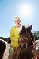 Liisa Joronen, founder of Finnish corporation SOL, poses for the photographer with one of her ponies at her home in the Var, France, 11 April 2012