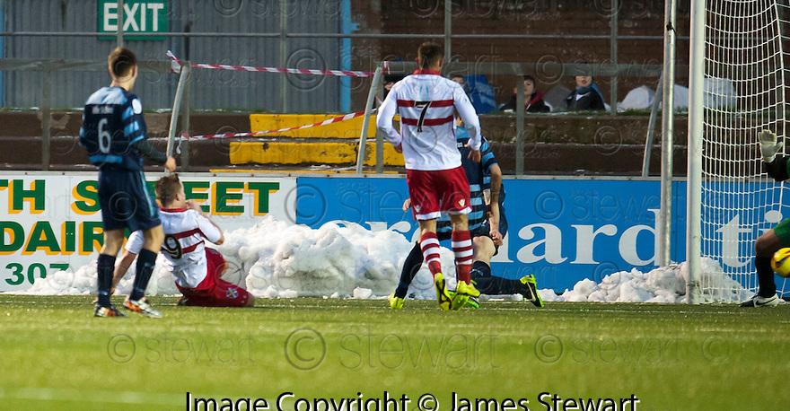 Stirling's Steven Doris (9) scores their first goal.